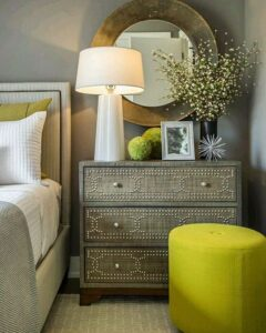 15-a-neutral-bedroom-can-be-spruced-up-with-greenery-pillows-and-ottomans